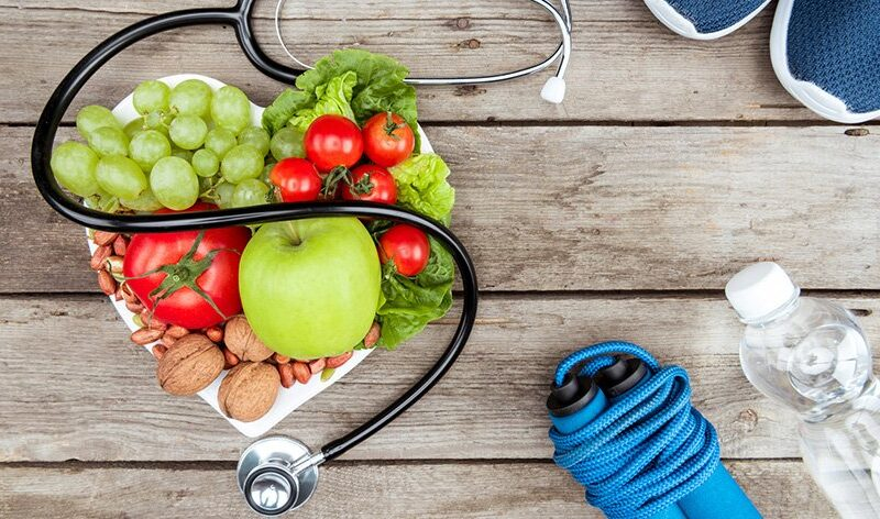 Heart health heart month Stethoscope organic food and sport equipment